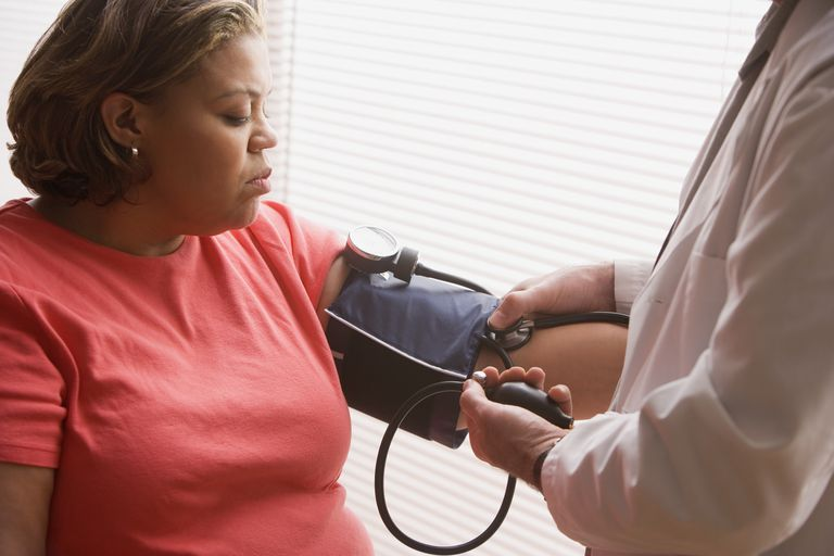 middle-aged-overweight-hispanic-woman-having-her-blood-pressure-checked-71417917-5948861e3df78c537b18f740 چرا فشار خون بالا میرود